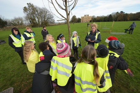 Helen Humphries leading a school group in tree planting