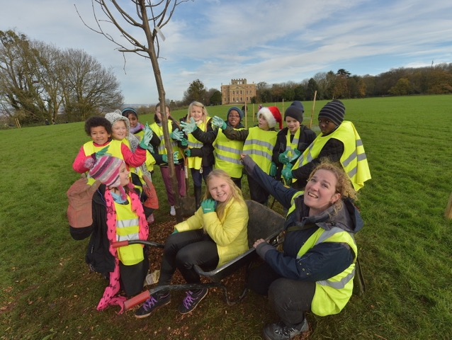 School children lend Helen Humphries of Bristol Tree Pips a welcome hand