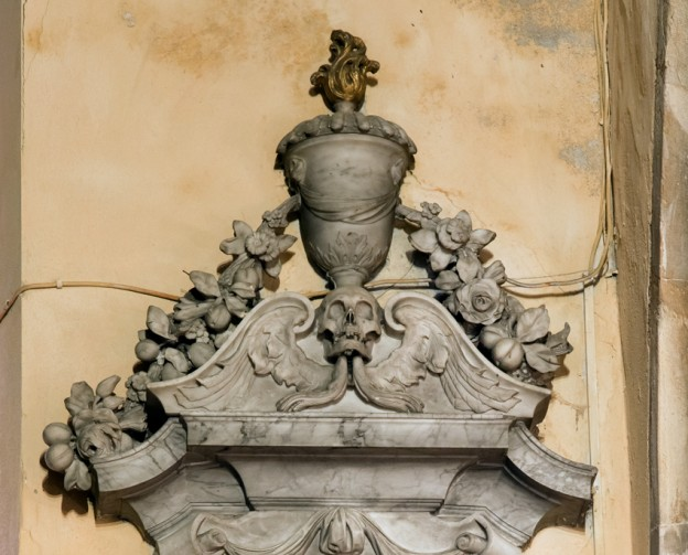 Detail of Grinling Gibbon's work for Elizabeth Southwell's memorial in Henbury church. The swags of fruit and flowers and the winged skull are characteristic of some of his best work.